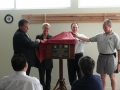 Councillor John Koutras, Kirstie Marshall - State Member for Forest Hill, Colin Organ and Stuart Miller - President of the Box Hill Little Athletics Centre unveil the plaque