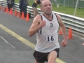 Steve Dinneen crosses the finish line to win Division 1