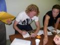 Steve signs autographs